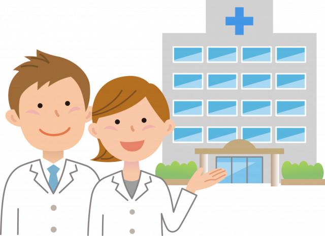 2人の白衣を着た男女が病院の前で笑顔で待っているイラスト